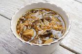 Homemade mushroom soup closeup on wooden table — Stock Photo