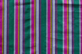 Colorful indian striped material background — Stock Photo