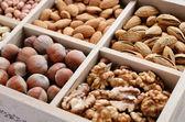 Nut mix in wooden box - walnut, almond, hazelnut, cashew and pea — Stock Photo