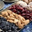 Mixed dried fruits and nuts in oriental style — Stock Photo #23894365