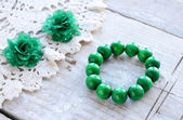 Green wooden beads bracelet — Stock Photo