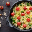 Homemade baked minced meat with cheese and cherry tomatoes — Stock Photo #24753323