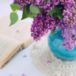 Beautiful lilac flowers in turquoise vase — Stock Photo