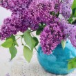 Stock Photo: Beautiful lilac flowers in turquoise vase