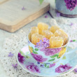 Still life with marmalade candies and lilac flowers — Stock Photo