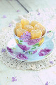 Cup with homemade oramge jelly bars — Stock Photo