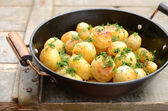 Whole fried potato in old wok — Foto Stock