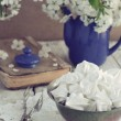 Still life in vintage style with meringue kisses and cherry flow — Stock Photo