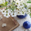 Cherry flowers bunch in blue pot and old book laying on vintage — Stock Photo #25978817