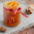 Homemade candied peels orange jam in glass jar — Stock Photo