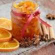 Homemade candied peels orange jam in glass jar — Stock Photo #26060641