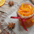Homemade candied peels orange jam in glass jar — Stock Photo #26078021