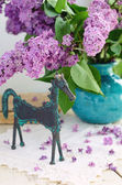 Decoration with horse statuette and lilac — Stock Photo
