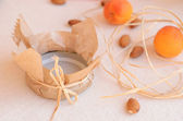 Jar lid wrapped up with paper and bow — Stock Photo