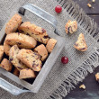 Cranberry biscotti in wooden box — Stock Photo #28363431