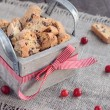 Cranberry biscotti in wooden box — Stock Photo #28363683