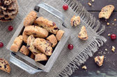 Cranberry biscotti in wooden box — Stock Photo