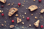 Cranberry biscotti on wooden background — Stock Photo