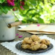 Walnut cookies on garden table — Stock Photo