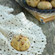 Walnut cookie over crochet doily — Stock Photo