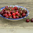 Sweet cherry in blue oriental bowl — Stock Photo #29093567
