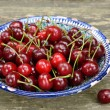 Sweet cherry in blue oriental bowl — Stock Photo #29093623