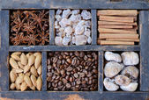 Coffee, nuts and spices in rusted wooden box — Foto Stock