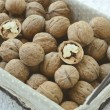 Walnut in wire basket — Stock Photo