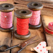 Stock Photo: Decoration with wooden spools and red ribbons