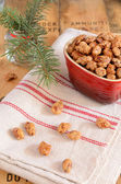 Caramelized almonds and Christmas tree twigs — Stock Photo