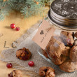 Christmas decoration with cookies, cranberry and fir tree branch — Stock Photo