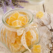 Orange jelly bars in glass jar — Stock Photo #33625305
