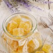 Orange jelly bars in glass jar — Stock Photo #33625315