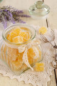 Orange jelly bars in glass jar — Stockfoto