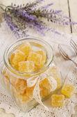 Orange jelly bars in glass jar — Stock Photo