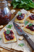 Toasts with plum chutney topped with coriander leaves — Stock Photo