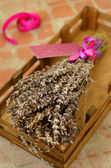Bunch of dried lavender in wooden tray — Stock Photo