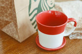 Red and white Starbucks coffee cup — Stock Photo