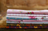 Pile of floral pattern textile in shabby style — Stock Photo