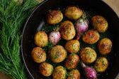 Homemade whole fried young potato and onion — Stock Photo