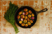 Whole baked young potato and young oinion and bunch of fresh dil — Stock Photo