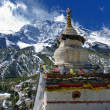 Buddhist stupa with the Annapurna III — Stock Photo