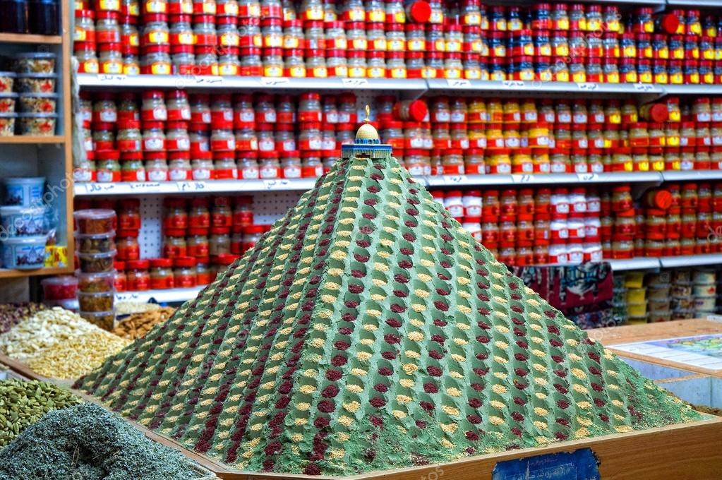 Colourful pyramid heaped with spices, in the background of the grocery store shelves, Jerusalem, Israel — Stock Photo #13522274