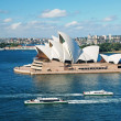 Sydney opera house with ferrys in foregournd - Stock Photo