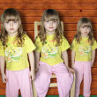 Stock Photo: Three identical girls