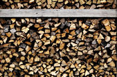 Wood drying in a stack for firewood. — Stock Photo