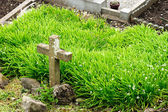 En kyrkogård cross — Stockfoto