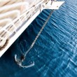 Foto Stock: Anchor pulling