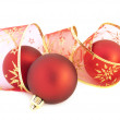 Christmas baubles and ribbon — Stock Photo