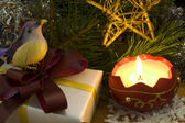 Christmas decoration with bird and candle — Stock Photo